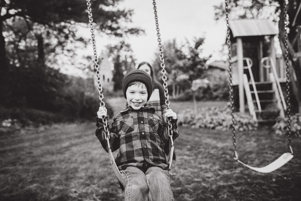 little boy on swings