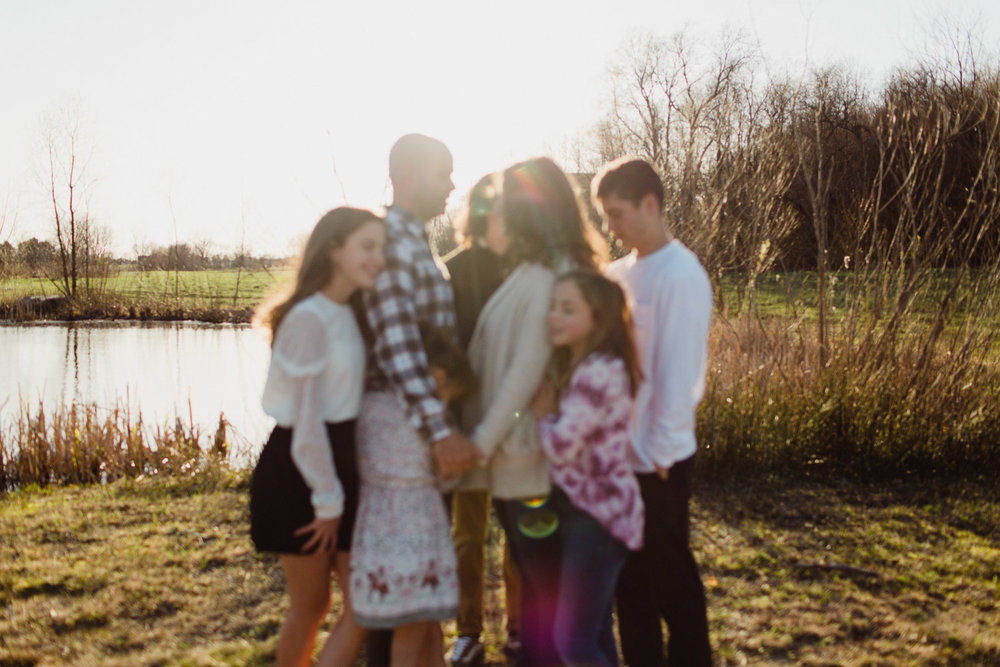 Family held together in evening light