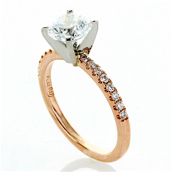 thin 14 karat rose gold and platinum prong set engagement ring
