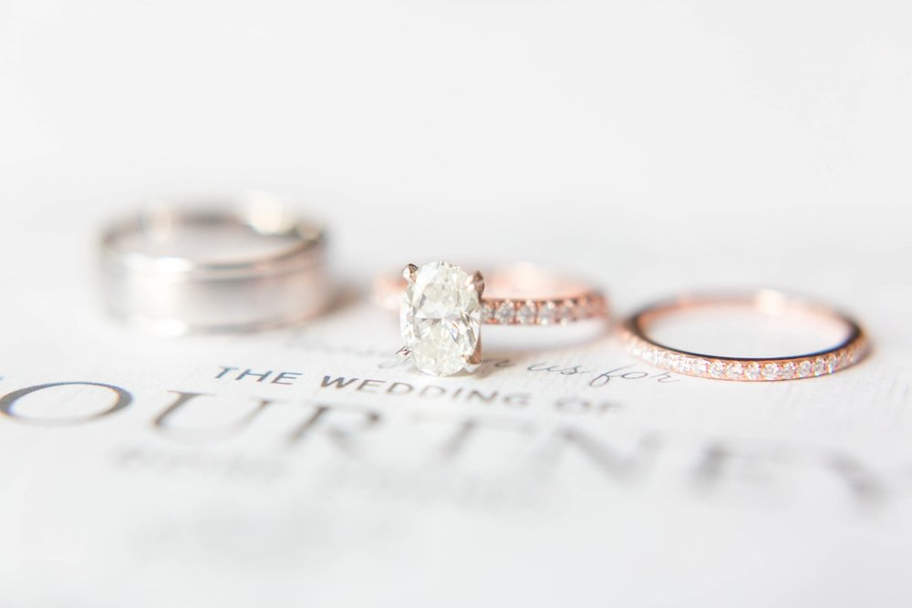 The beautiful wedding band set from one of our incredible couples on their wedding day. Photography by Mallorie Gayle.