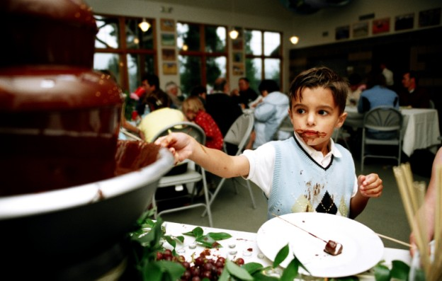 Look at that concentration and chocolate-dipping skill! | photo [robinjohnsonphoto.com]