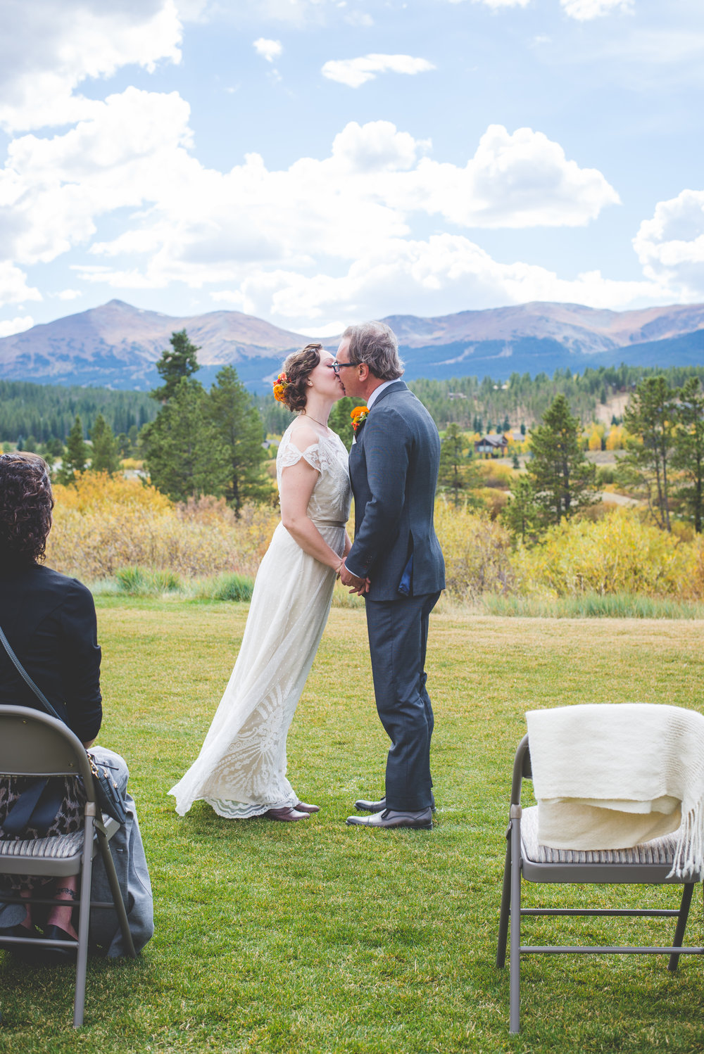 colorado bride and groom seal their vows with a kiss at their breckenridge fall elopement