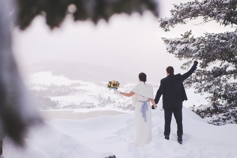 Yes! celebrate! they did it - they eloped! sapphire point has a stunning view, and even though the low winter clouds covered the mountains in the distance, the views didn't disappoint! | photo by keeping composure photography