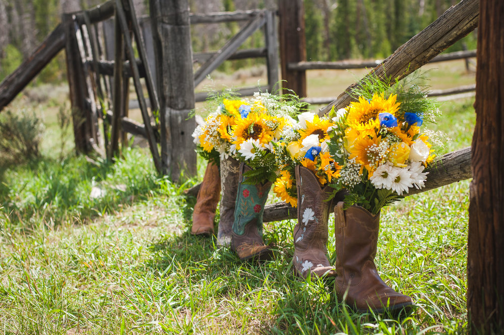 cowgirl boots with sunflower bouquets
