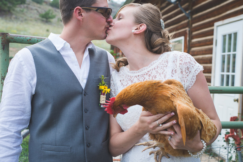 bride and groom with chicken