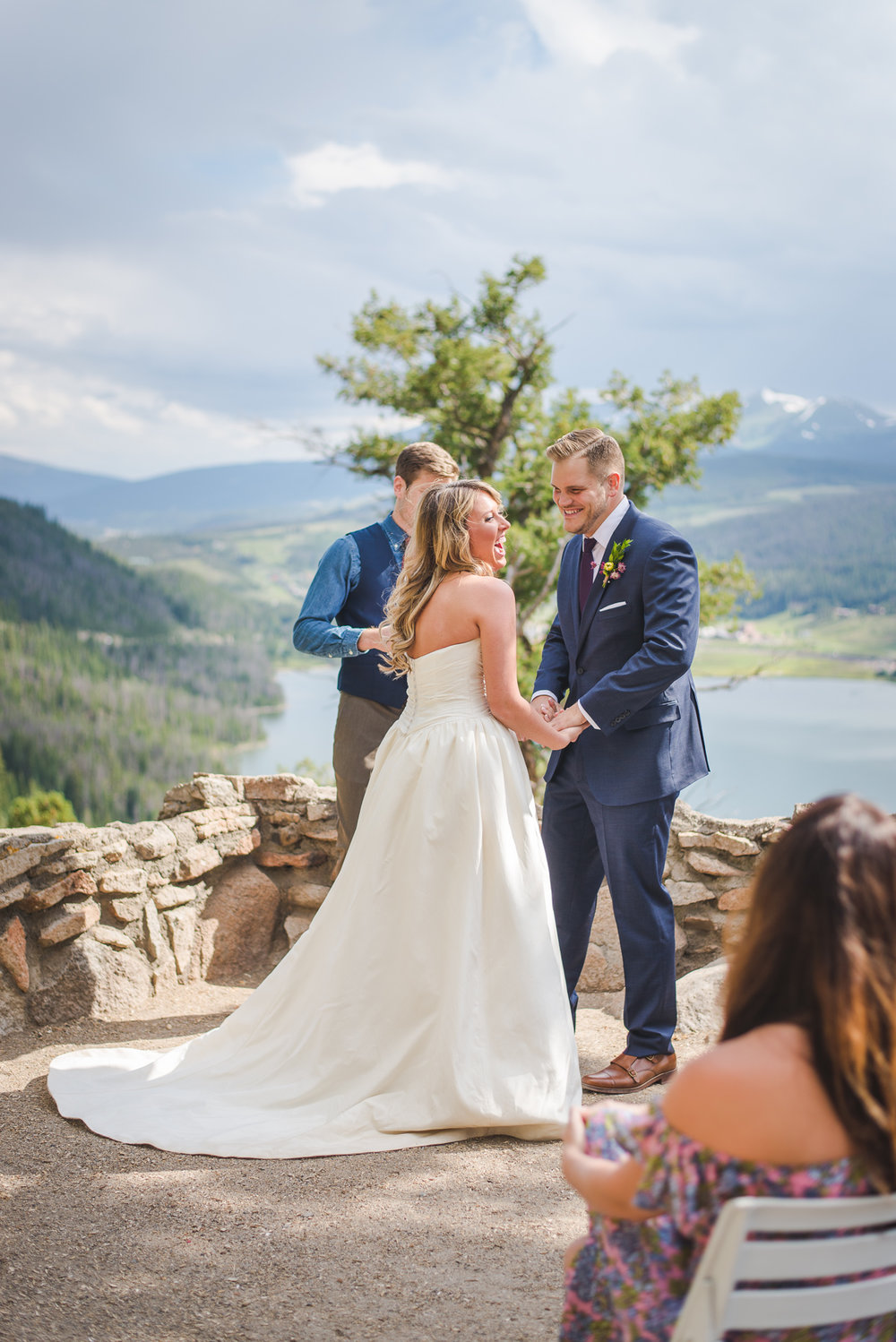 colorado bride and groom laughter small wedding by lake dillon | summit mountain weddings