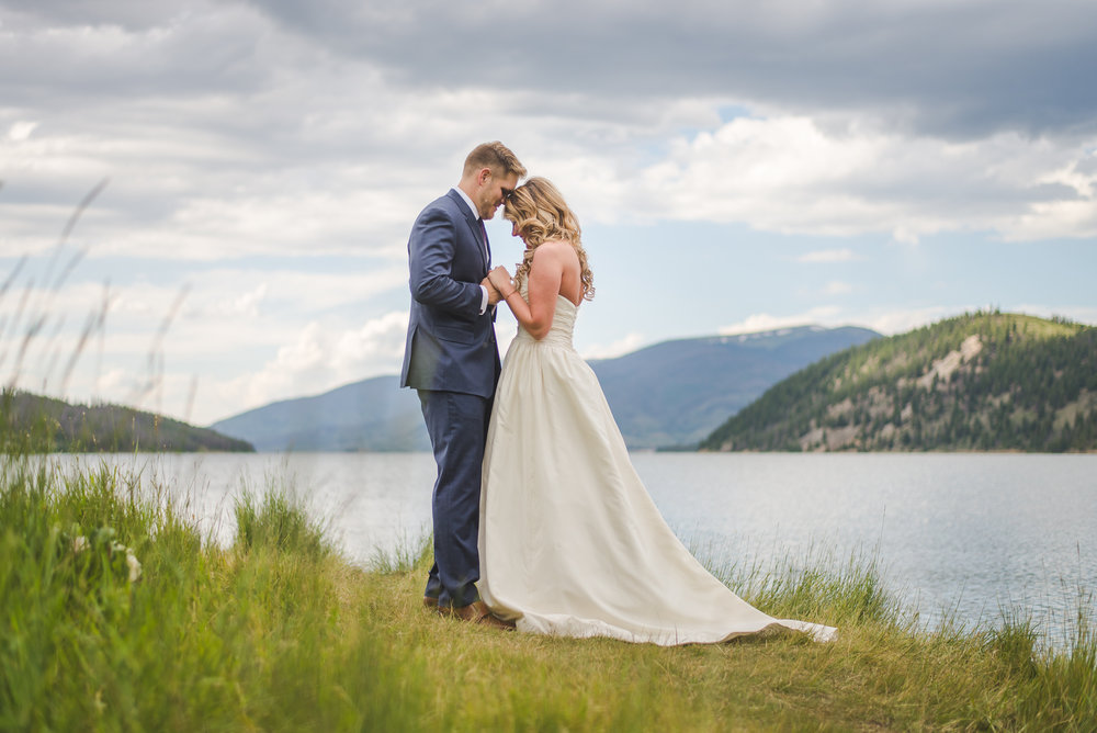 colorado bride and groom elopement prayer by lake dillon | summit mountain weddings