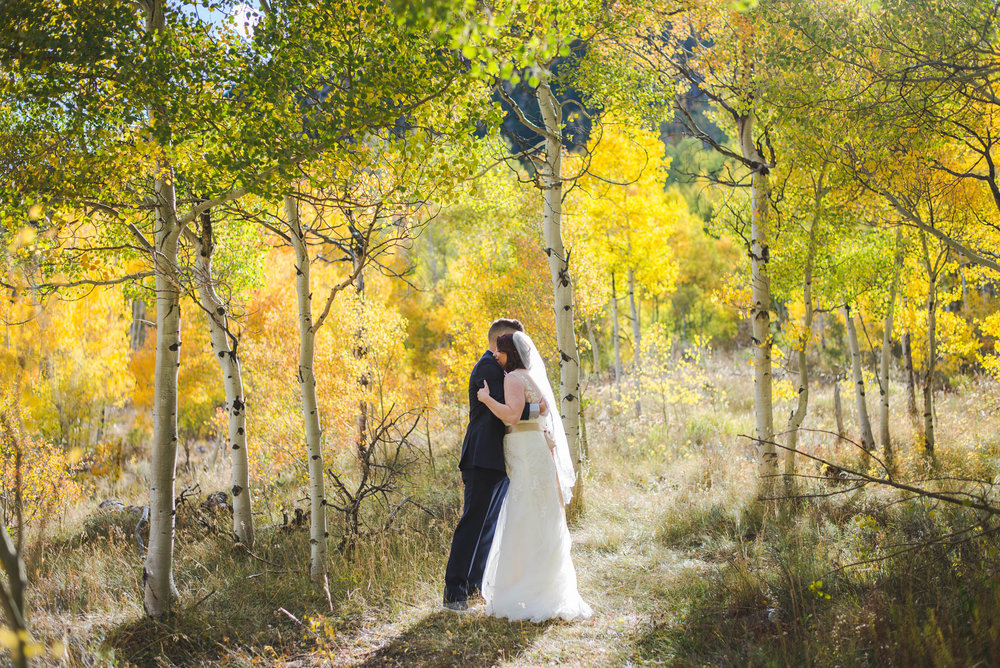 fall bride and groom yellow aspens colorado mountains
