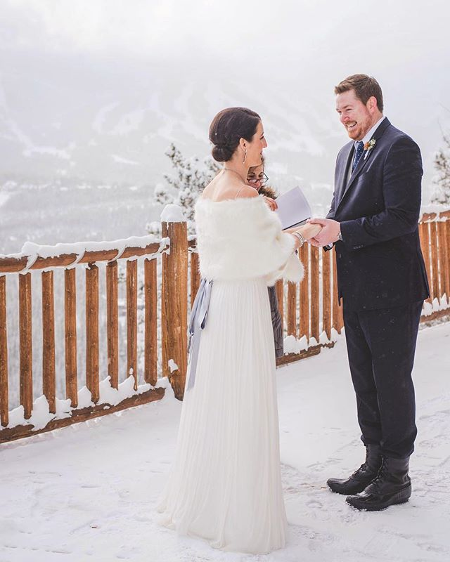 "Those mid-ceremony, ""holy moly how is it THIS cold?!"" giggles...⠀ .⠀ I'll remember this elopement forever. We got over 18 inches of fresh snow overnight, and it was brutally chilly outside. These southern babes decided to rough it and still exchanged vows outside, overlooking the clouds barely clearing enough to see the ski runs at Breck.⠀ .⠀ We headed to another spot afterwards for a new view. Knee-deep in snow, we all trudged through it to get just the right spot.⠀ .⠀ Did it take me three days to warm up afterwards? Probably.⠀ Did a car get stuck only to blow out the tire shortly thereafter...? We'll never tell. 😉⠀ .⠀ Was it worth it? 100%"