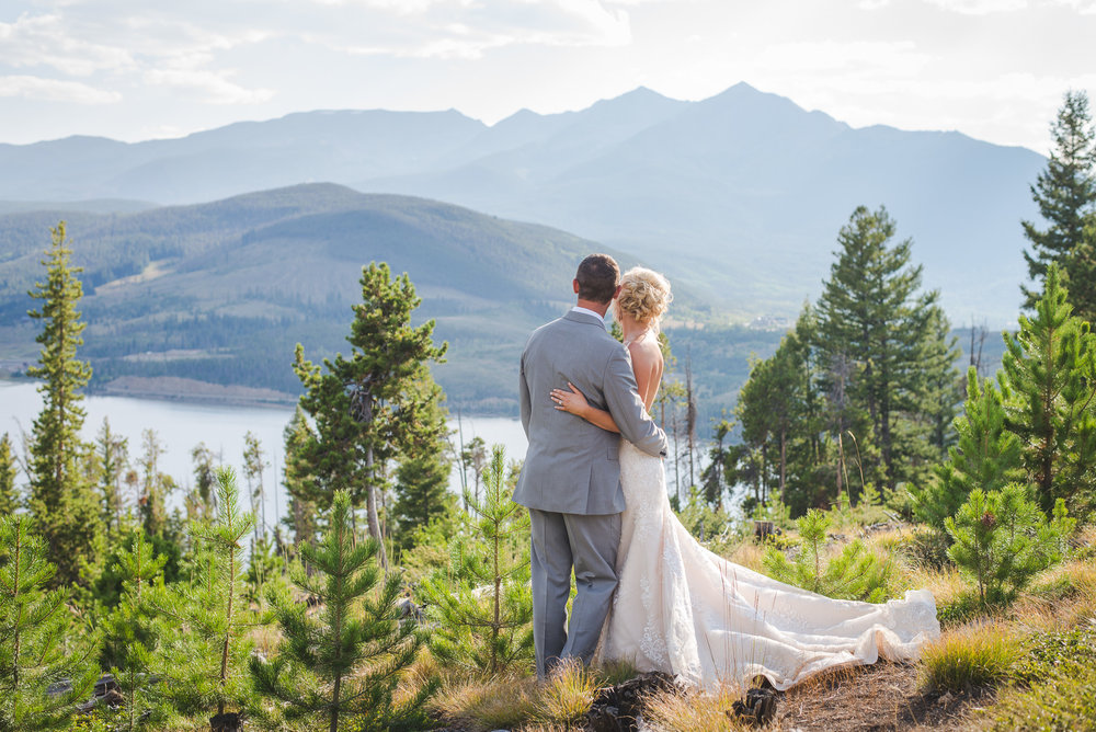 bride and groom overlooking lake dillon