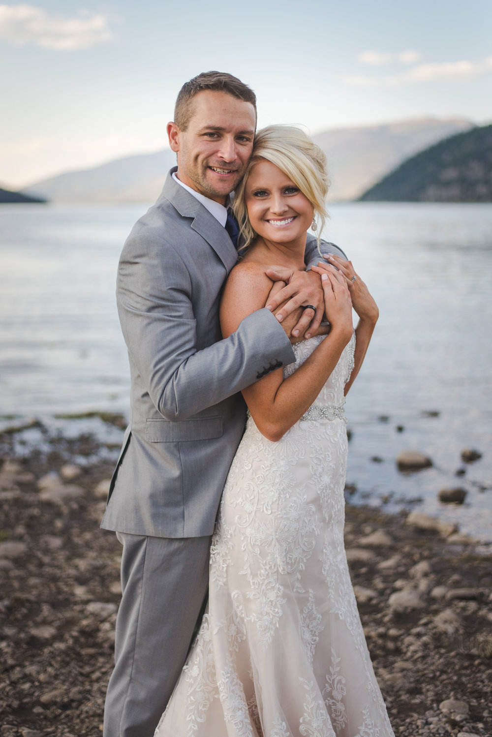 lakeside photos with bride and groom