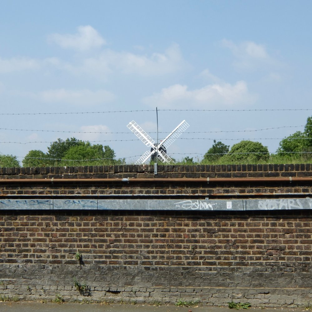 5 Windmill sails over barbed wire.jpg
