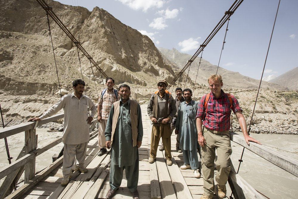My expedition team standing on a suspension bridge over a tributary of the Indus River after the conclusion of my first expedition in Northern Pakistan in 2015. We'd just hiked high up into the Karakorum Range to photograph men mining literally on the sides of 500 metre cliff faces at altitudes in excess of 4000 metres.