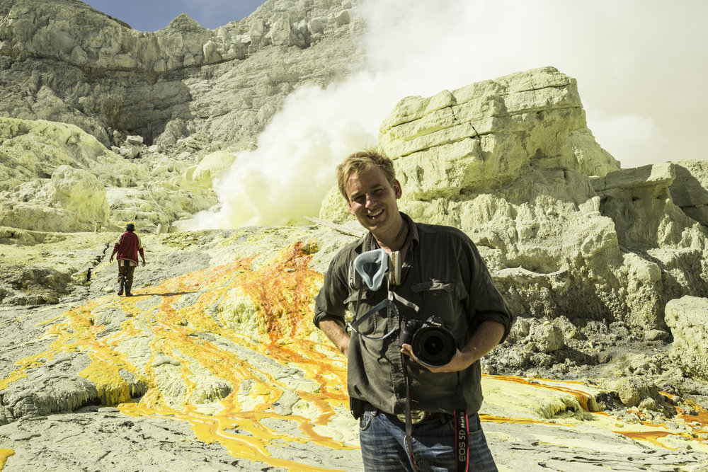 On location in the Ijen volcano on the Indonesian island of Java, 2013.  The gas seen in the background is from an active volcanic vent tapping into a magma chamber.  Gases can be as high as 600 degrees celcius when they reach the surface.