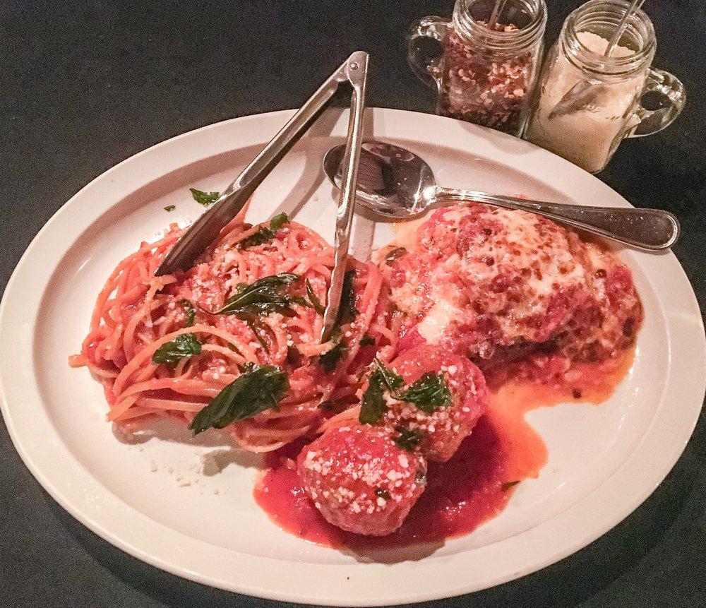 "Mama Maroni's famous Meatballs, fresh spaghetti and ""gagootz"" (zucchini parmesan)"