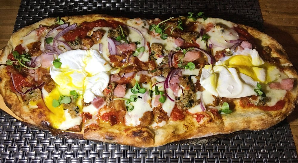 Farmhouse Pizza - Fresh Mozzarella, Smoked Bacon, Kotto Ham, Fennel Sausage, Roasted Onion, Farm Egg.