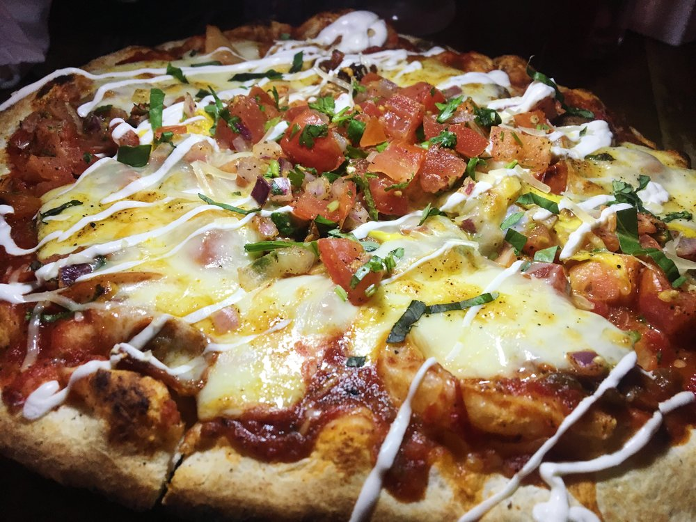 Huevos Ranchero Pizza – Sunny Side Up, Chorizo, Tomato, Monterey Jack, Pico de Gallo, Sour Cream Drizzle