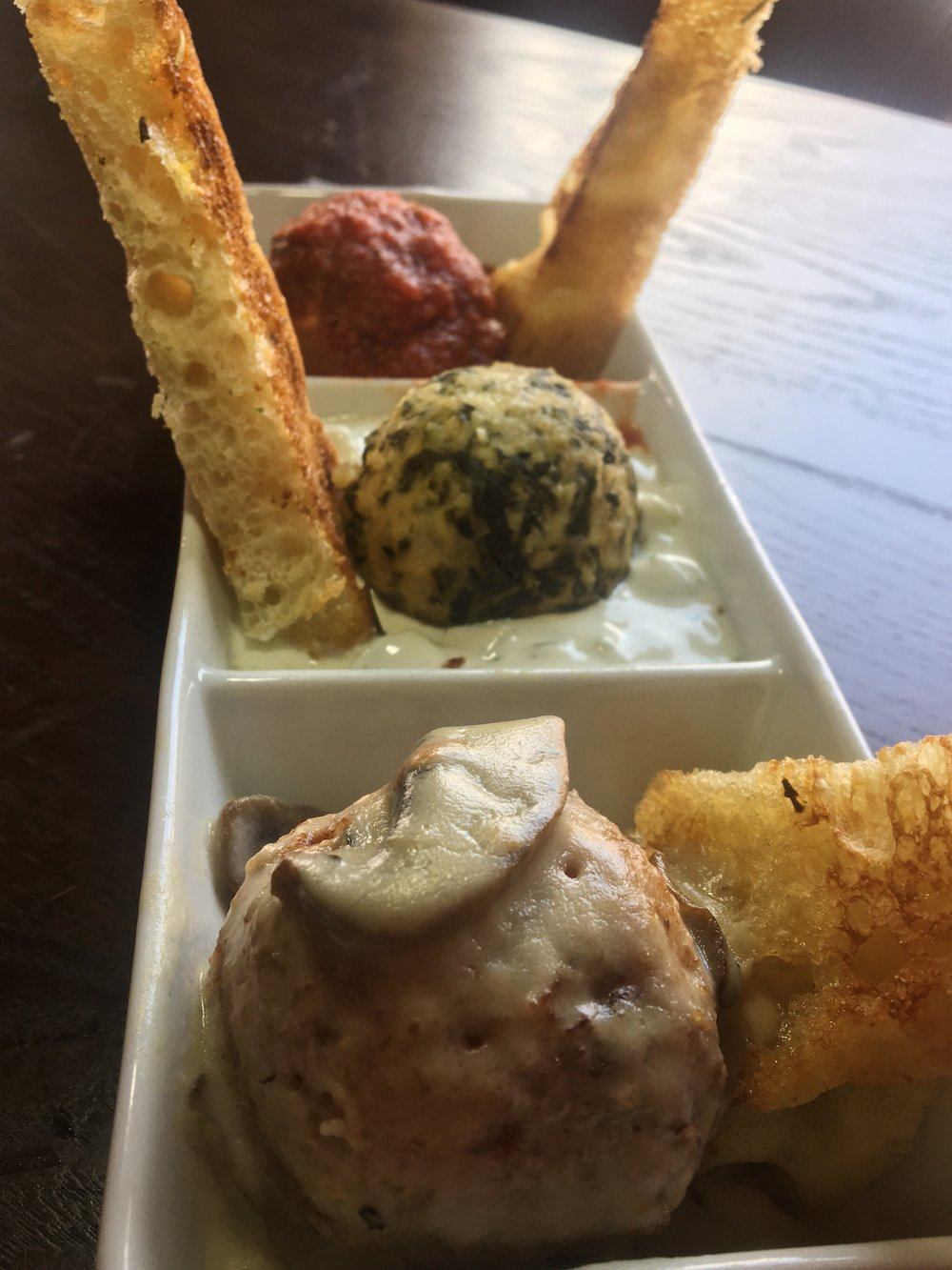 Front to back - Lobster Risotto Ball, Chicken Ball, Classic Meatball