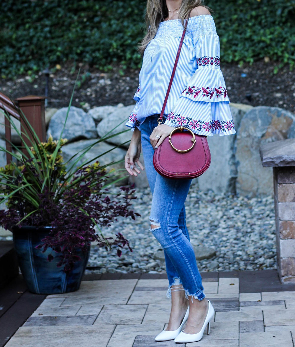 Statement sleeves, distressed jeans with a raw hem and Chloe nile bag