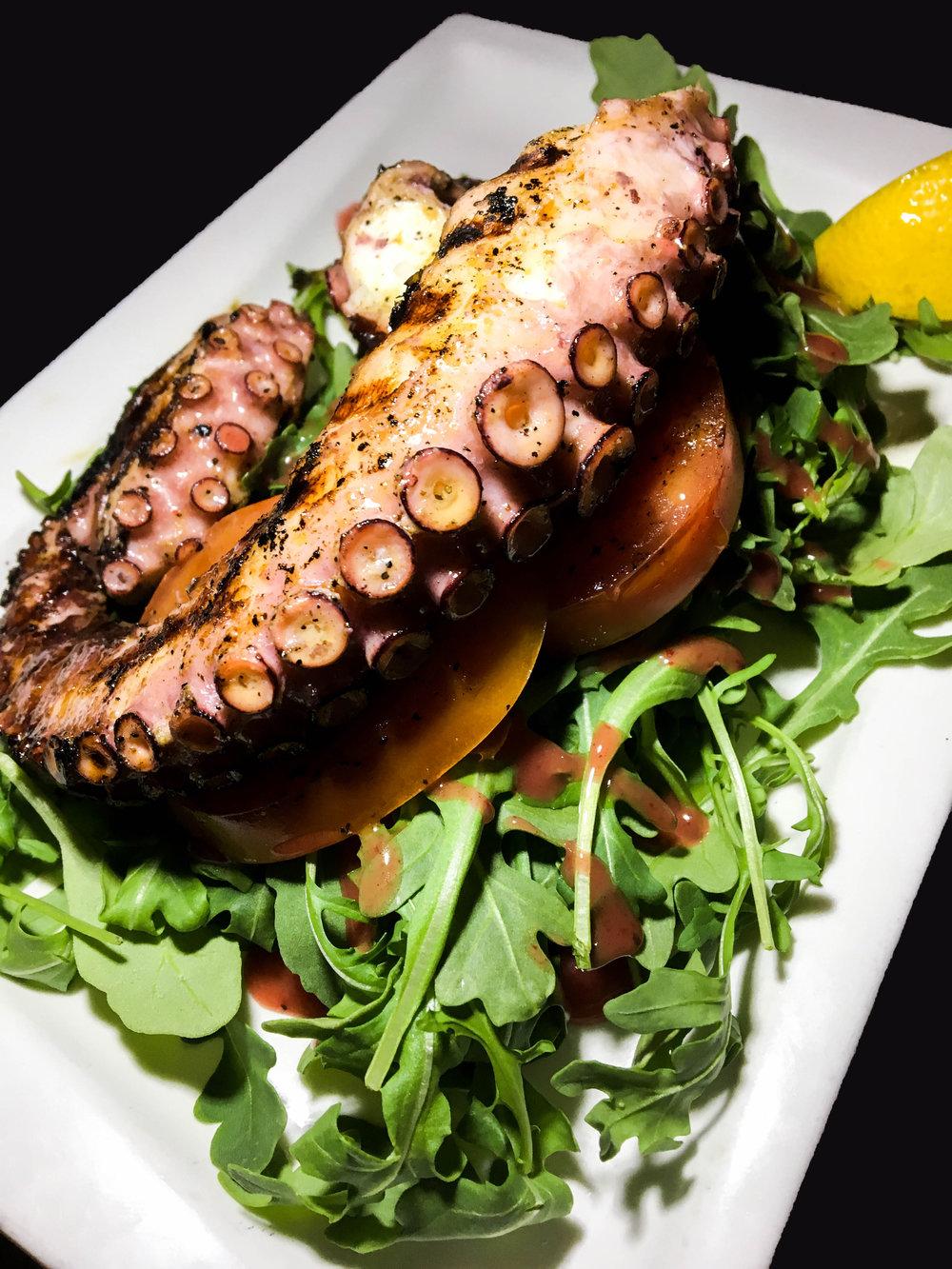 Grilled Mediterranean Octopus - Beefsteak Tomato, Arugula, Spanish EV Olive Oil