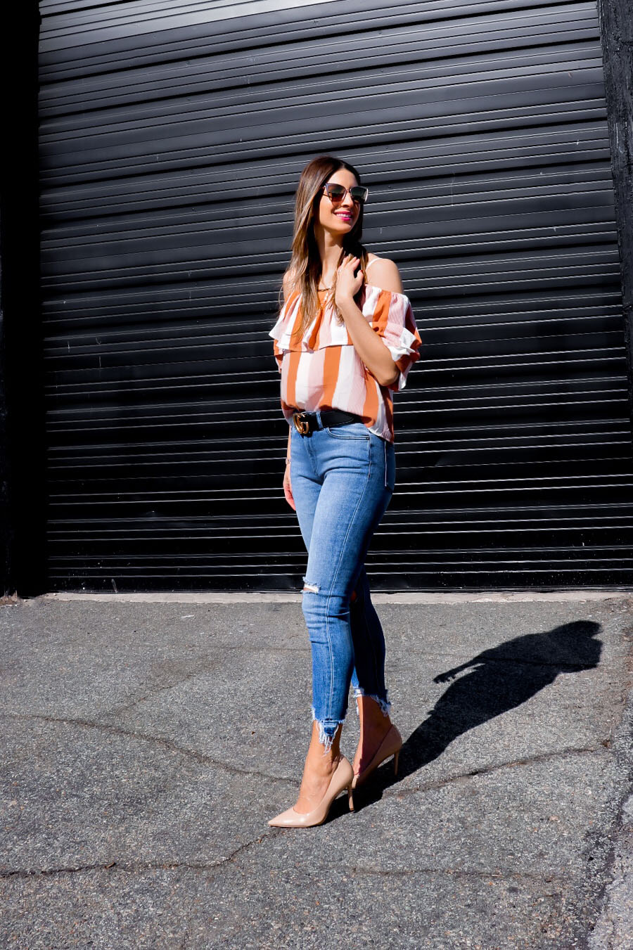 Spring ruffle top with distressed jeans