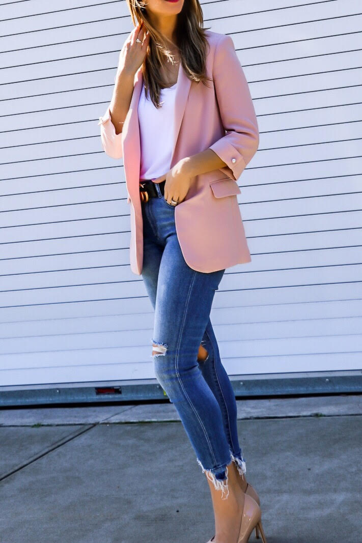pink blazer with distressed jeans