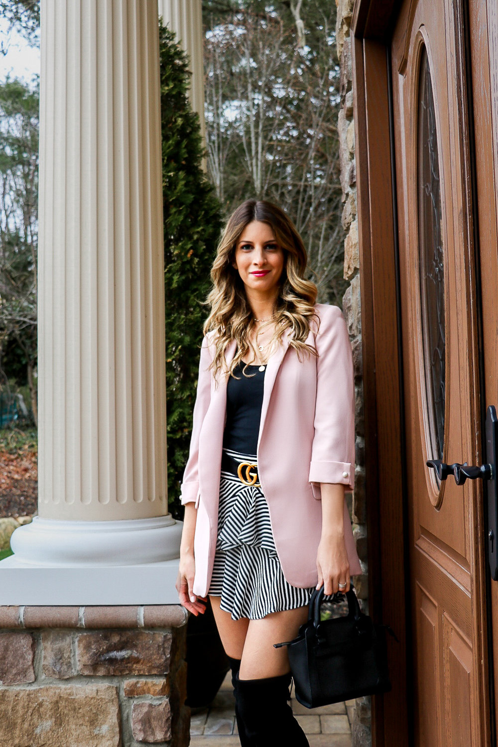 pink blazer with black and white skirt