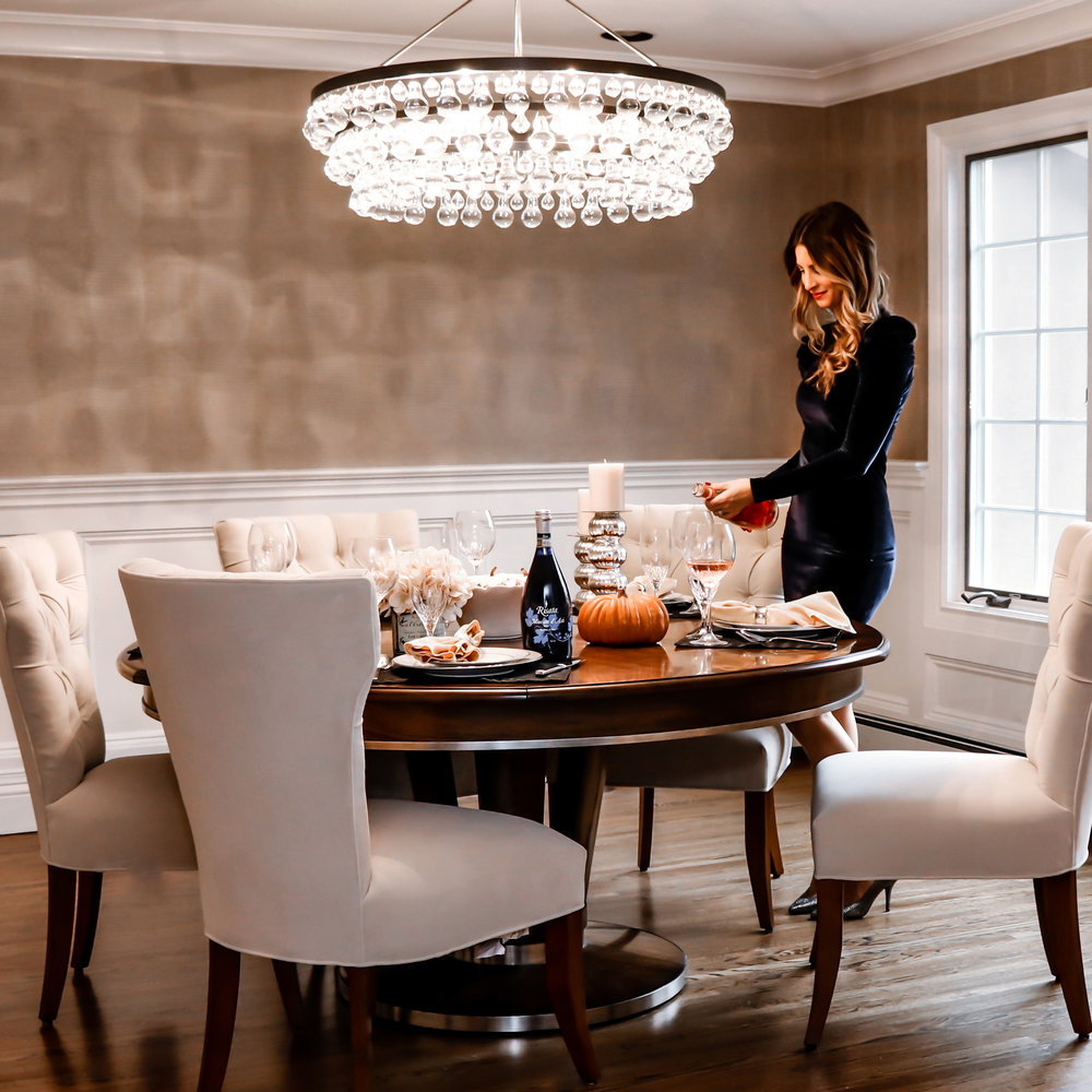 Dining Table –  Soho Jupe  / Chandelier –  Robert Abbey  / Chairs –  Designmaster