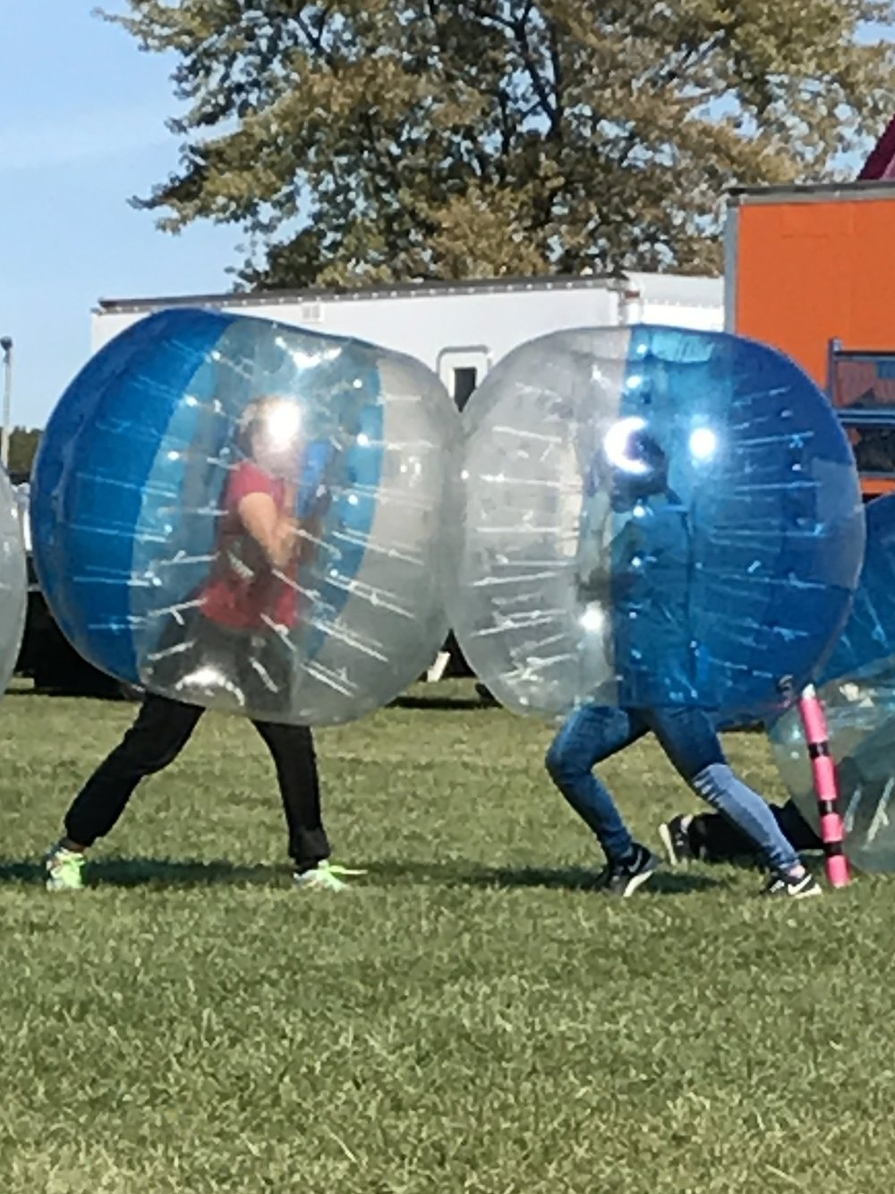 Hayley and her friends playing the Bubble Soccer!