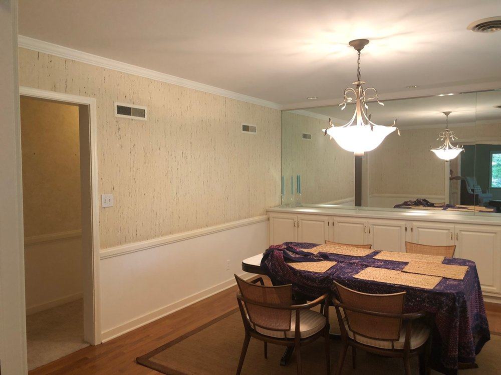 outdated dining room with wall mirrors