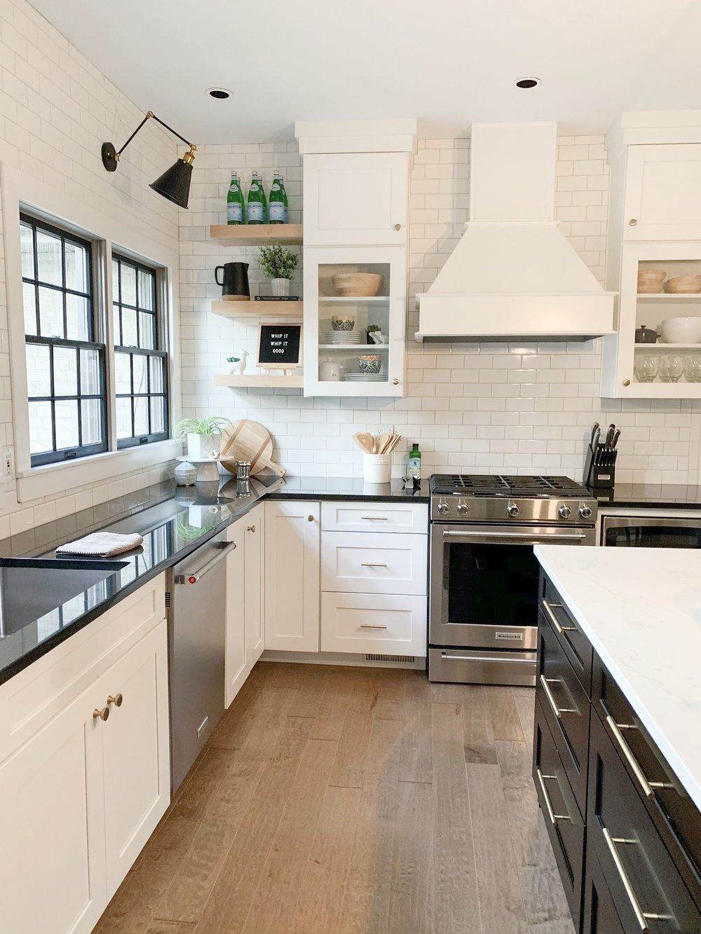 black and brass lights in white kitchen