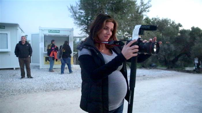Shooting at a refugee camp in Lesbos, Greece while 7-months- pregnant.  Thankfully, did not go into labor on this trip but the entire island told me I was having another boy (and they were right)  . Who needs a gender reveal cake?!