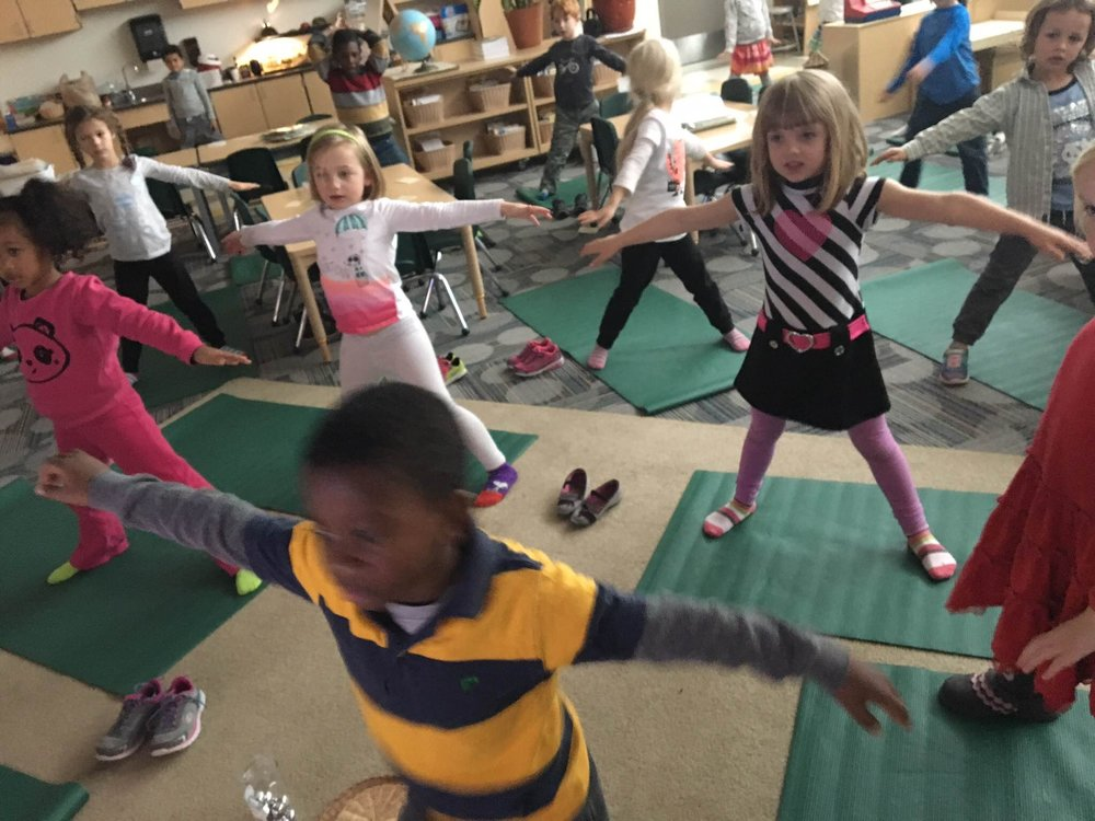 Students at Isaac Dickson Elementary Practicing Mindfulness through balancing.