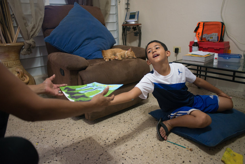 6/9/18 – Bayamón, Puerto Rico – Jayson Grau is a student in the second grade at Aurelio Perez Martinez, one of the schools set to close before the Fall. He tried another school before and had to repeat 1st grade, but has enjoyed Aurelio and thrived there, according to his mother and grandmother.The Puerto Rican Department of Education is closing 283 schools, and moving multiple schools into the same building, citing the past year's drastic drop in enrollment as one of the primary reasons to lower the amount of schools, and instead increase the amount of students in each school. Students of special education schools are one of the groups to be most negatively affected by these closings, as the new schools may not offer the resources the students need and have access to at their current schools. (Sofie Hecht Photography)