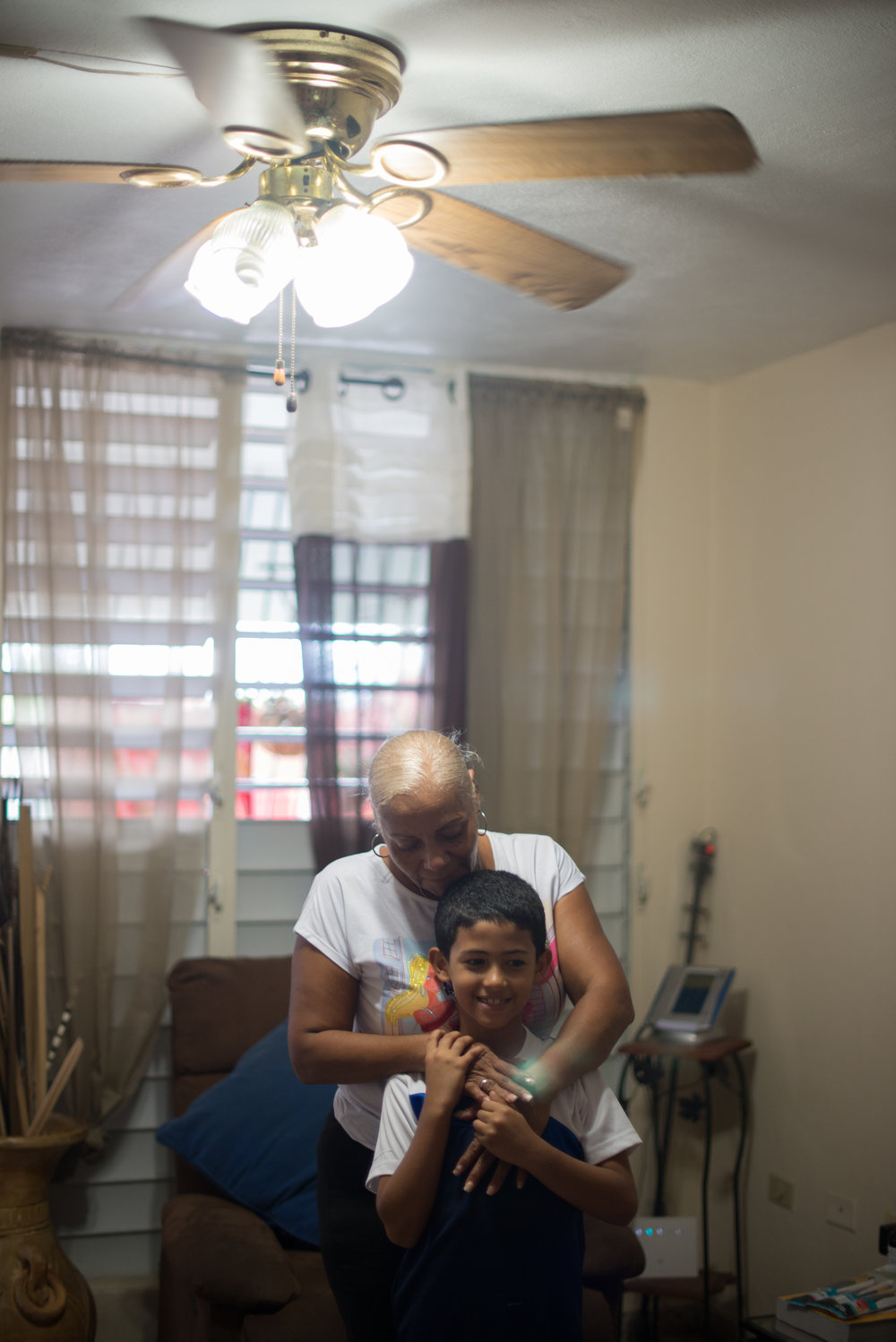 6/9/18 – Bayamón, Puerto Rico – Jayson Grau is a student in the second grade at Aurelio Perez Martinez, one of the schools set to close before the Fall. His grandmother Wanda takes the kids to school while their mother works, and lives at an apartment nearby to theirs so that she can help take care of the whole family.The Puerto Rican Department of Education is closing 283 schools, and moving multiple schools into the same building, citing the past year's drastic drop in enrollment as one of the primary reasons to lower the amount of schools, and instead increase the amount of students in each school. Students of special education schools are one of the groups to be most negatively affected by these closings, as the new schools may not offer the resources the students need and have access to at their current schools. (Sofie Hecht Photography)