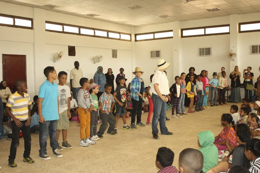 Teaching Sudanese students a Texas line dance for International Day