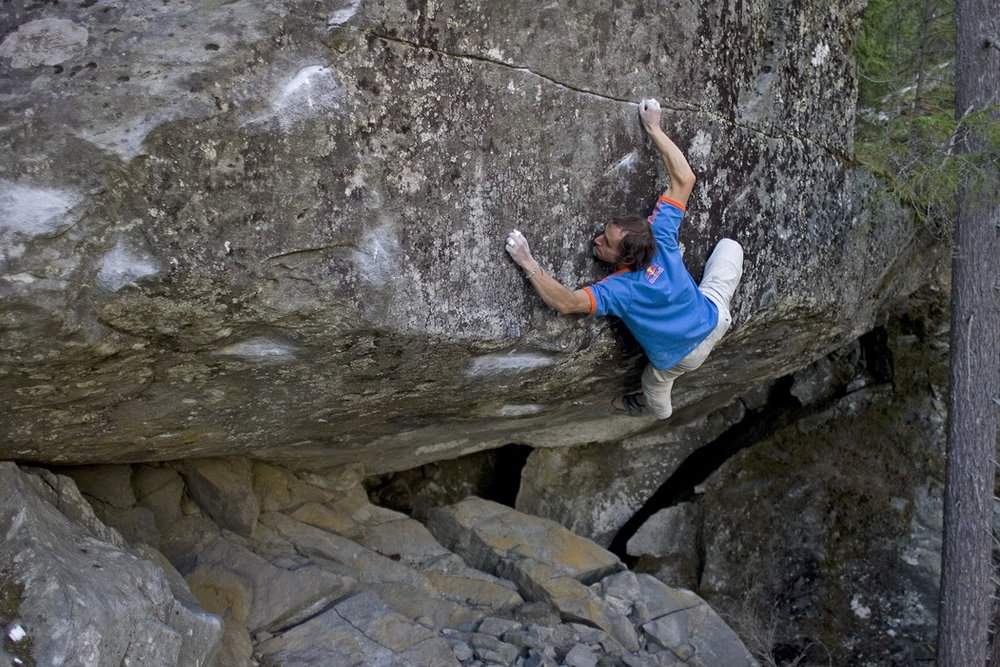 Bernd Zangerl on  Tintenfischalarm  8a+ (V12). Photo:  Beat Kammerlander