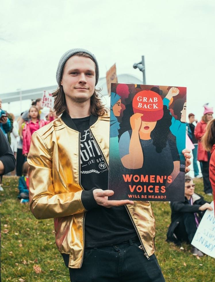 A protester using the poster as a sign at the women's march.