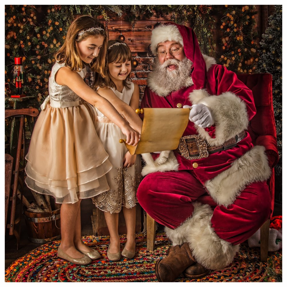 santa with girls and listFB.jpg