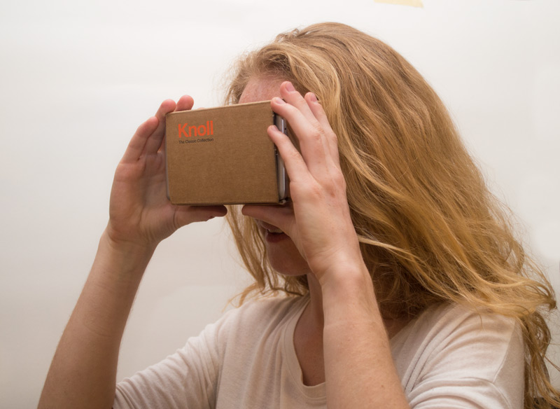 - User holding a (Knoll branded) Google Cardboard to view the prototype. The prototype demonstrates how the interface would appear over an environment, however since it is a YouTube video utilizing the Cardboard feature, the buttons are not interactive.