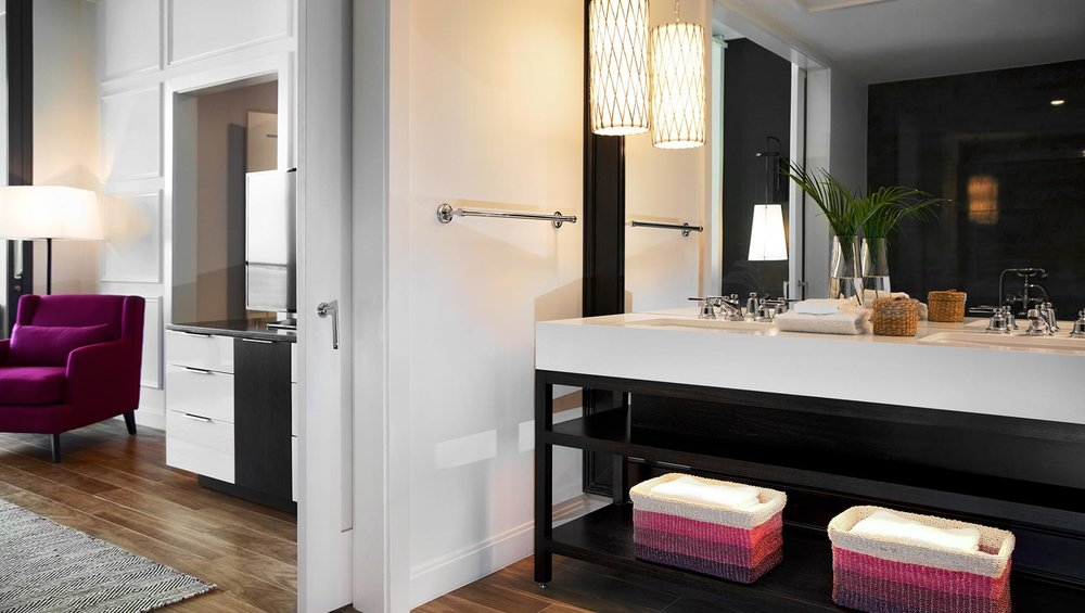 Bathroom vanities, mirrors, wall paneling and trim.