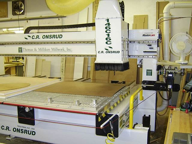 Onsrud 5' x 12' CNC router    This high speed computerized router made in North Carolina allows us to cut curves and irregular shapes from autocad drawings. It selects its own tools and cleans up after itself. A vacuum lift permits large work to be lifted on and off the router single-handed.