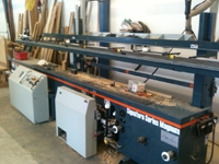 Northfield Magnum custom door hanging machines Machines door slabs and jambs for hinges, lockset, bore, and strike A vacuum lift makes it possible for one operator to feed and remove the door slabs.