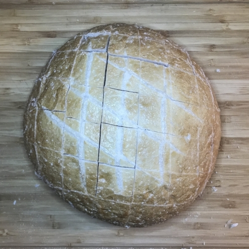 - 1. Preheat oven to 350° Cut 1 inch strips lengthwise across the bread, only cutting 3/4 way down through the loaf. Turn the loaf 180°, and cut 1 inch strips the other direction so you end up with 1 inch cubes all across the bread (See picture)