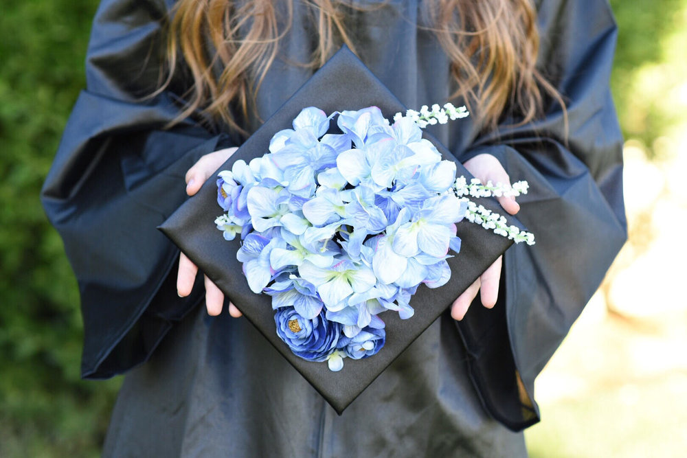 This is my daughter, displaying her graduation cap, at her high school graduation ceremony.