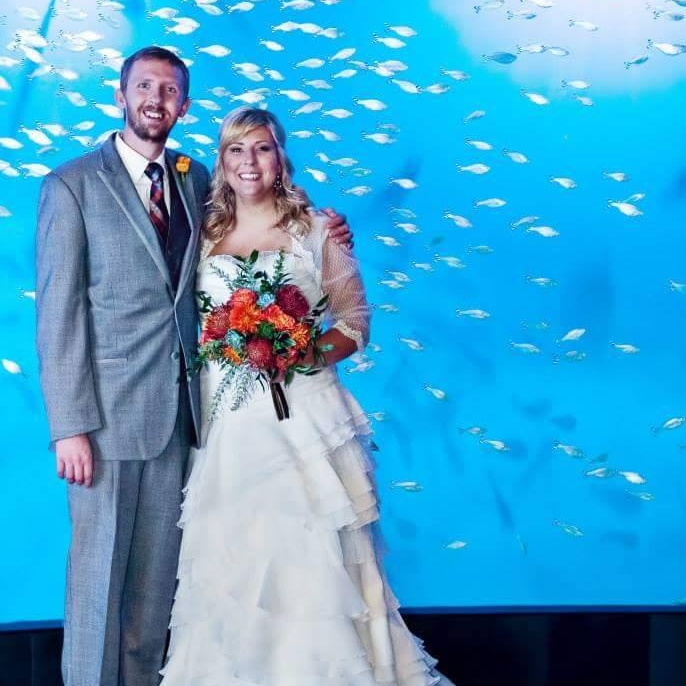 Brian & Sarah Meints ~ Omaha, NE    We LOVE our wedding guest book frame that people signed their names and wrote notes to us in the sea creatures! We have the perfect place to hang it in our new home, and have received so many compliments on it already. It isn't even hung up yet :-)    Photo By: Mary Angregg Photography