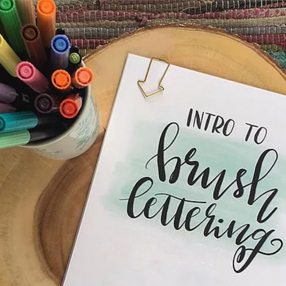 Brush Lettering Basics - Join us for a two hour Brush Lettering Workshop! No prior calligraphy or lettering experience is necessary, just lots of patience and enthusiasm!This workshop includes all materials you'll need, as well as plenty of supplies to take home with you and continue your brush lettering practice.This class focuses on the techniques needed to gain control of brush markers to achieve brush lettering and faux calligraphy. Through lots of practice and completing set exercises, you'll put your strokes into practice and explore making many beautiful hand-lettered items. This class is for anyone and everyone who has an interest in lettering! We'll be starting with the basics so we can achieve a good understanding of brush lettering techniques. Complete beginners welcome. No experience necessary!Seats are limited to 12 spaces, so reservations are essential.