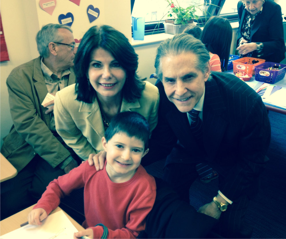 Millie, John, and their grandson at school