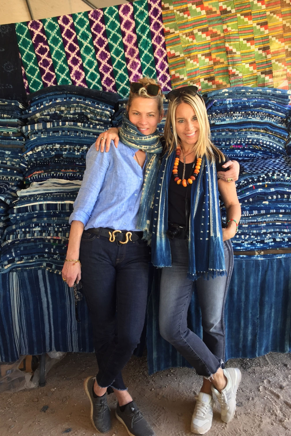 Anuschka and Lynda surrounded by indigo dyed textiles from Mali