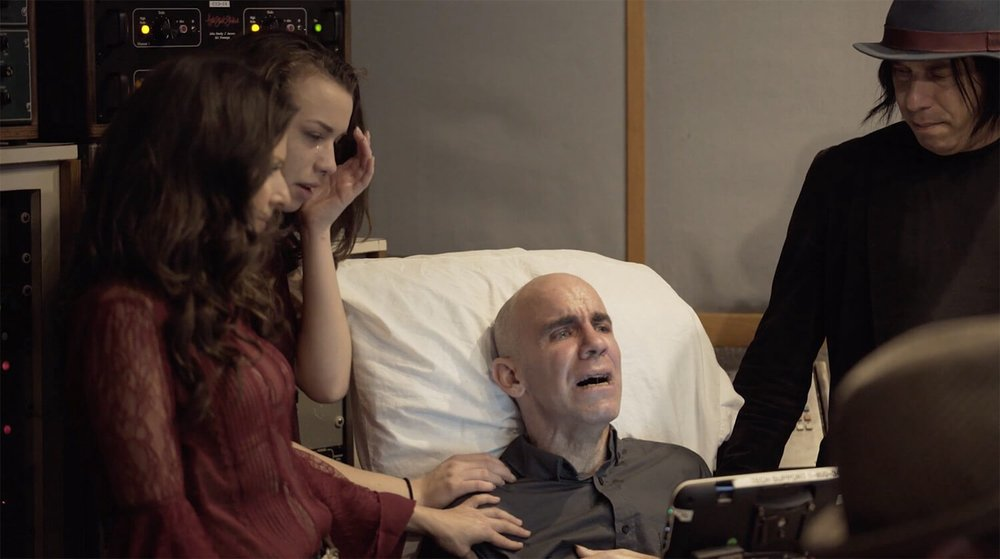 Essence, Nicole, Bernie, and Roger Rocha (left to right) in the hospital